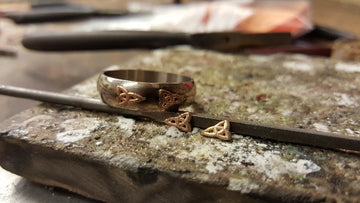 white gold d shape wedding ring before the yellow gold trinity knots get soldered onto the ring