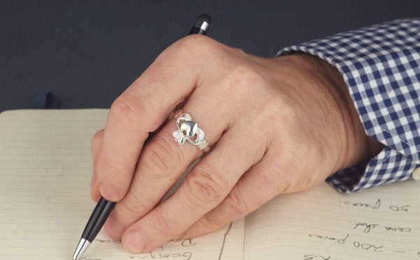 white gold gents classic claddagh ring as shown on a mans hand