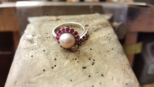 ruby and pearl cluster ring before it gets finished