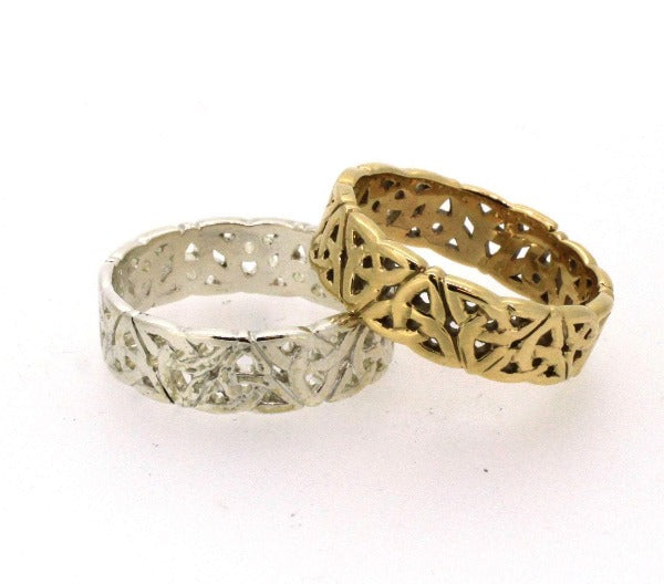 2 rings one white and one yellow gold celtic trinity knot rings, the ring has celtic trinity knots alternating point up and point down the full way around the ring