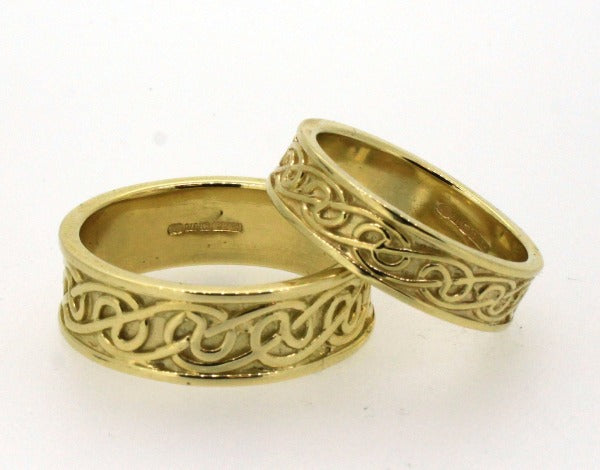 9ct yellow gold celtic lovers knot matching his and hers wedding ring sets, the celtic design is in the middle of 2 raised edges