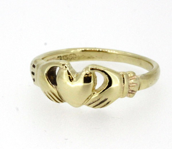 yellow gold ladies friendship ring , the 2 hands are holding the heart.