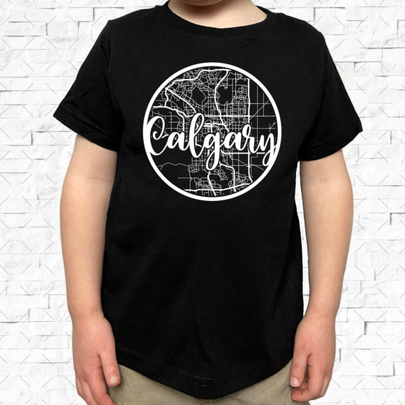 toddler-sized black short-sleeved shirt with white Calgary hometown map design