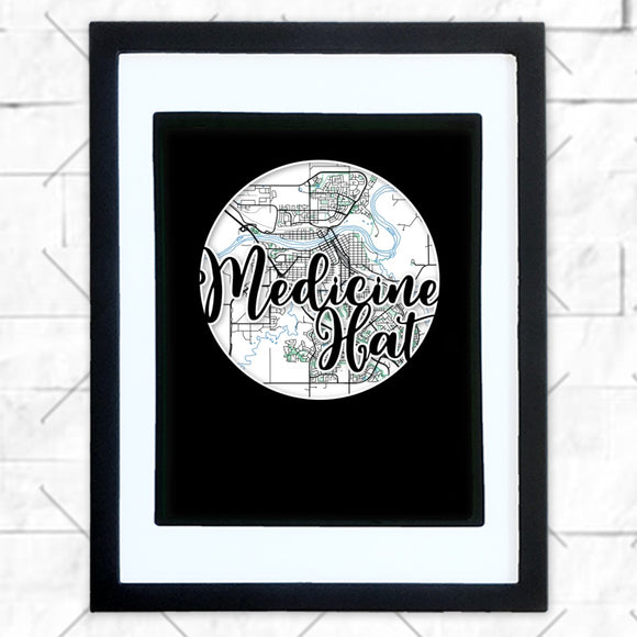 Close-up of Medicine Hat hometown map design in black shadowbox frame with white matte