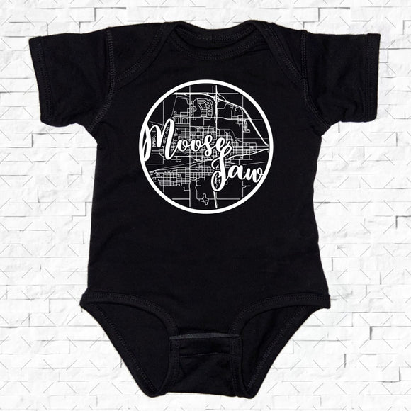 baby-sized black short-sleeved onesie with Moose Jaw hometown map design