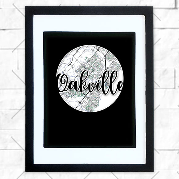 Close-up of Oakville hometown map design in black shadowbox frame with white matte
