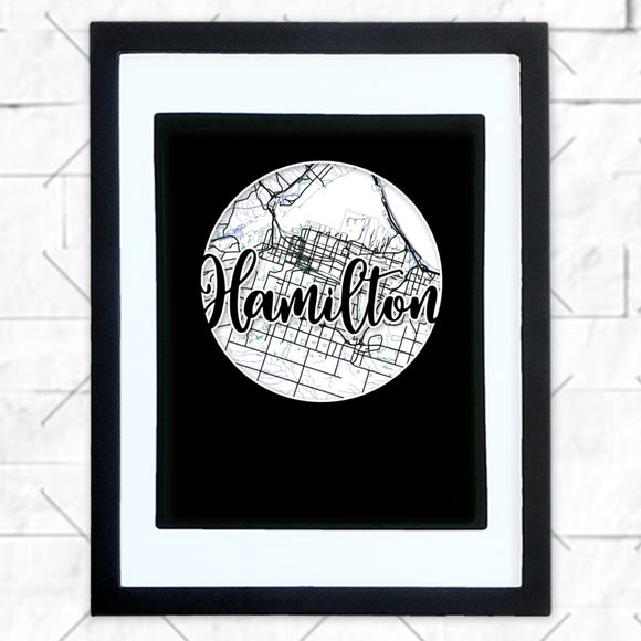 Close-up of Hamilton hometown map design in black shadowbox frame with white matte
