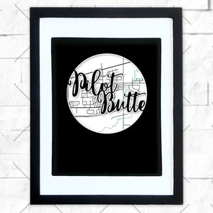Close-up of Pilot Butte hometown map design in black shadowbox frame with white matte