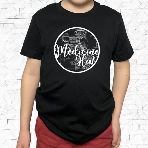 youth-sized black short-sleeved shirt with white Medicine Hat hometown map design