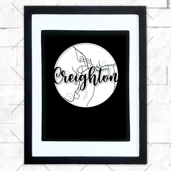 Close-up of Creighton hometown map design in black shadowbox frame with white matte