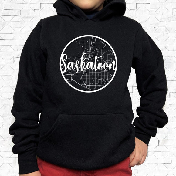 youth-sized black hoodie with white Saskatoon hometown map design