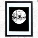 Close-up of Shellbrook hometown map design in black shadowbox frame with white matte