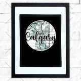Close-up of Calgary hometown map design in black shadowbox frame with white matte