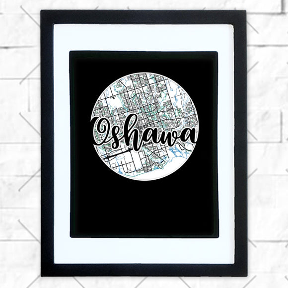 Close-up of Oshawa hometown map design in black shadowbox frame with white matte