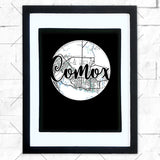 Close-up of Comox hometown map design in black shadowbox frame with white matte