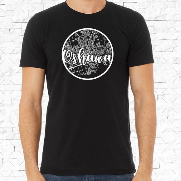 adult-sized black short-sleeved shirt with white Oshawa hometown map design