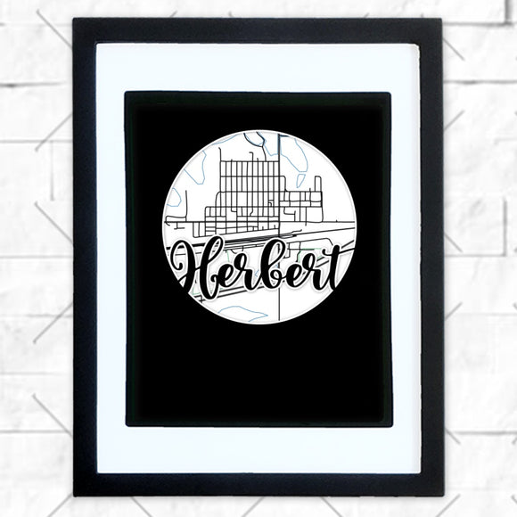 Close-up of Herbert hometown map design in black shadowbox frame with white matte