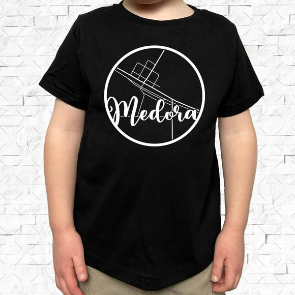 toddler-sized black short-sleeved shirt with white Medora hometown map design