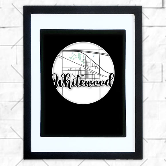 Close-up of Whitewood hometown map design in black shadowbox frame with white matte