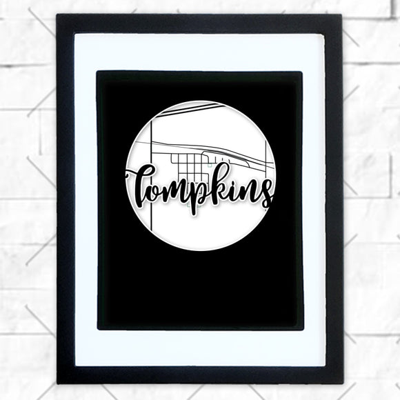 Close-up of Tompkins hometown map design in black shadowbox frame with white matte