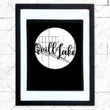 Close-up of Quill Lake hometown map design in black shadowbox frame with white matte