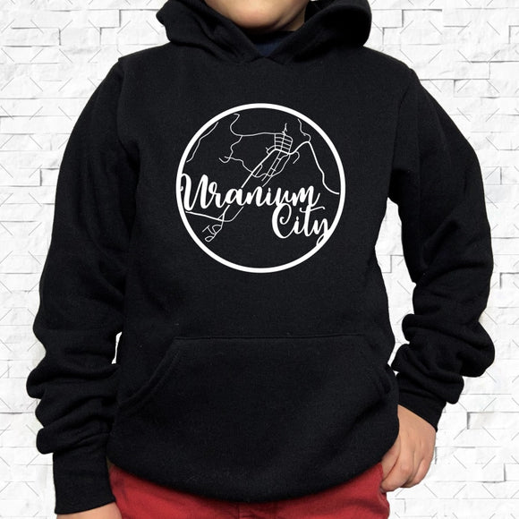 youth-sized black hoodie with white Uranium City hometown map design
