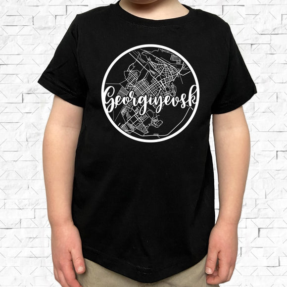 toddler-sized black short-sleeved shirt with white Georgiyevsk hometown map design