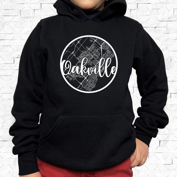 youth-sized black hoodie with white Oakville hometown map design