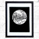 Close-up of Moncton hometown map design in black shadowbox frame with white matte