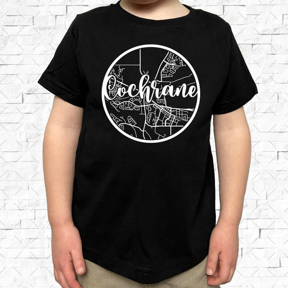 toddler-sized black short-sleeved shirt with white Cochrane hometown map design