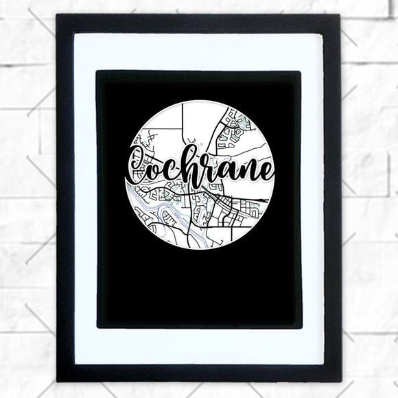 Close-up of Cochrane hometown map design in black shadowbox frame with white matte