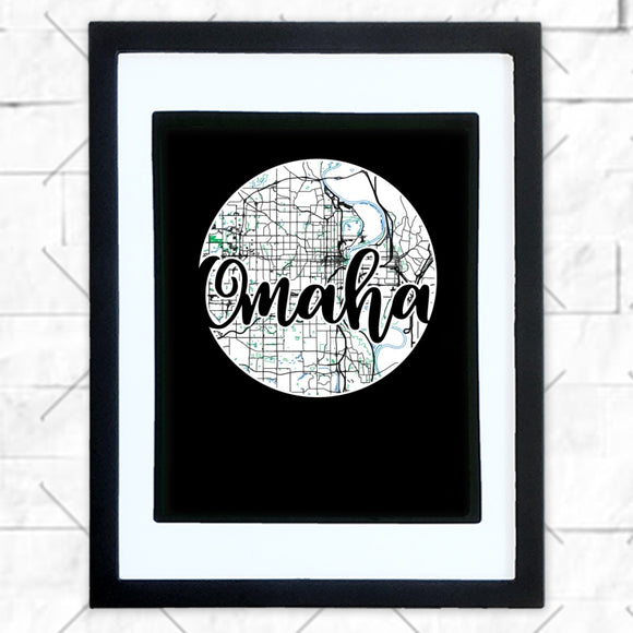Close-up of Omaha hometown map design in black shadowbox frame with white matte