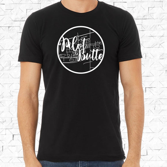 adult-sized black short-sleeved shirt with white Pilot Butte hometown map design