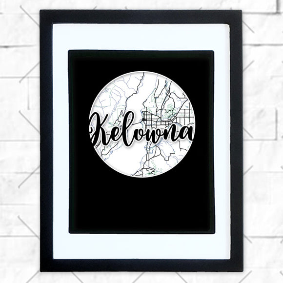 Close-up of Kelowna hometown map design in black shadowbox frame with white matte