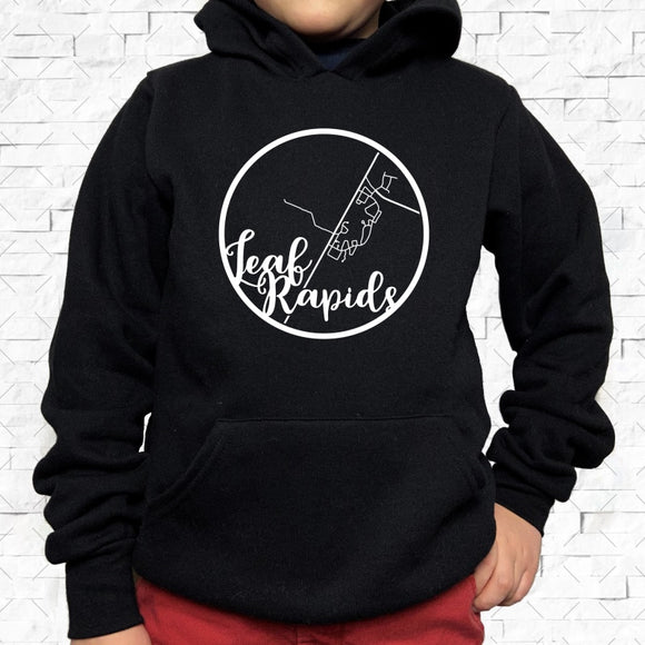 youth-sized black hoodie with white Leaf Rapids hometown map design