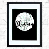 Close-up of Slocan hometown map design in black shadowbox frame with white matte