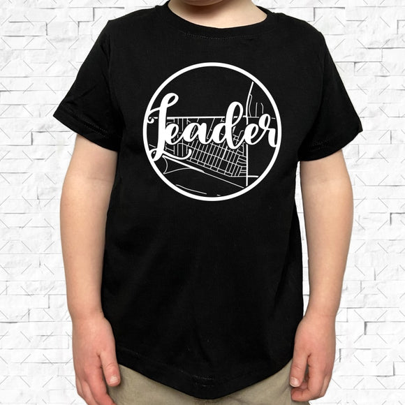 toddler-sized black short-sleeved shirt with white Leader hometown map design