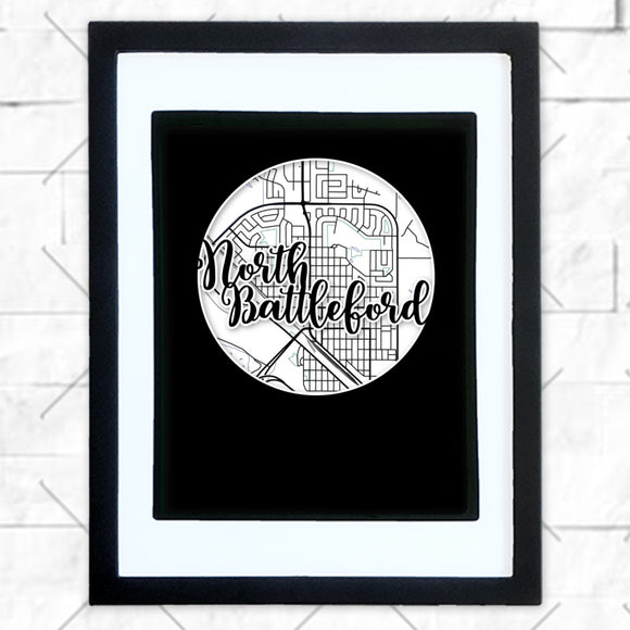 Close-up of North Battleford hometown map design in black shadowbox frame with white matte