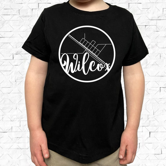 toddler-sized black short-sleeved shirt with white Wilcox hometown map design