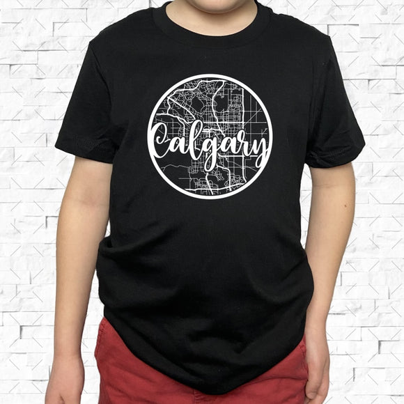 youth-sized black short-sleeved shirt with white Calgary hometown map design