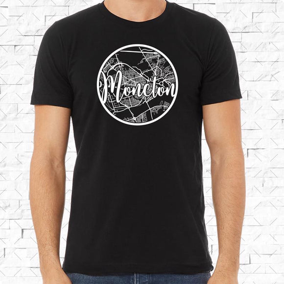 adult-sized black short-sleeved shirt with white Moncton hometown map design
