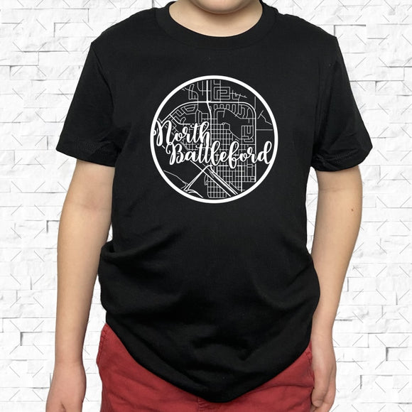 youth-sized black short-sleeved shirt with white North Battleford hometown map design