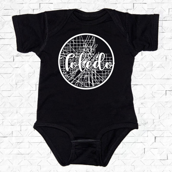 baby-sized black short-sleeved onesie with Toledo hometown map design