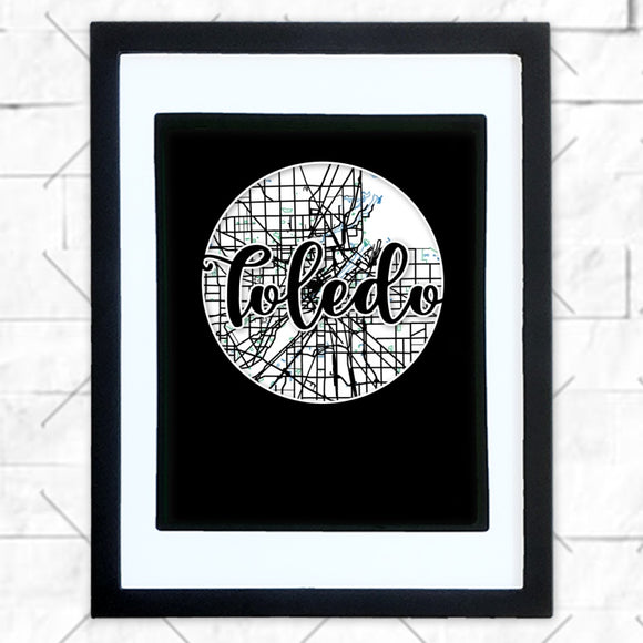 Close-up of Toledo hometown map design in black shadowbox frame with white matte