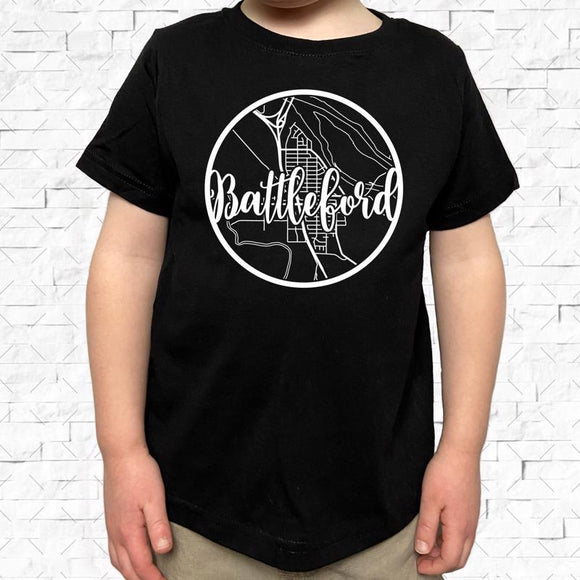 toddler-sized black short-sleeved shirt with white Battleford hometown map design