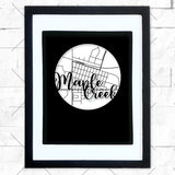 Close-up of Maple Creek hometown map design in black shadowbox frame with white matte