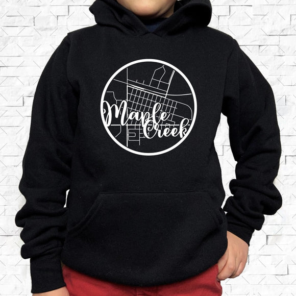 youth-sized black hoodie with white Maple Creek hometown map design