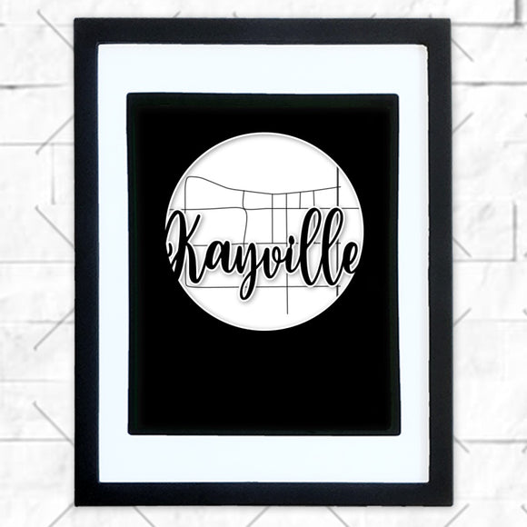 Close-up of Kayville hometown map design in black shadowbox frame with white matte