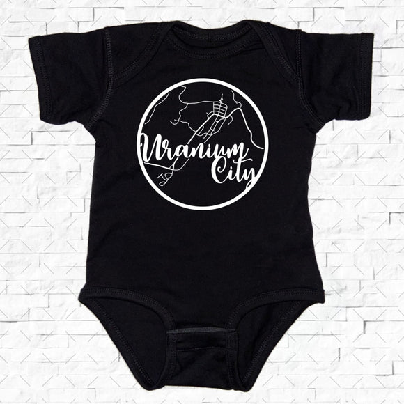 baby-sized black short-sleeved onesie with Uranium City hometown map design