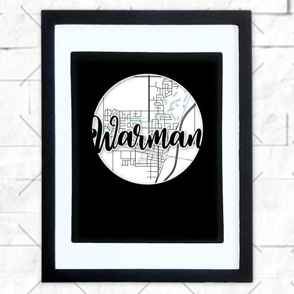 Close-up of Warman hometown map design in black shadowbox frame with white matte